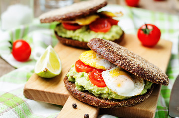 smashed avocado, tomatoes, egg sandwich