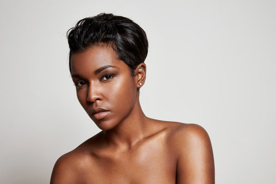 black woman with a short hair looking at camera