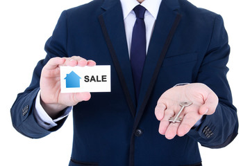male real estate agent hands with key and visiting card isolated