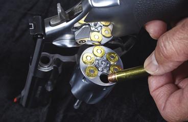 Man Loading Magnum Revolver Gun