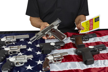 Man with guns For Sale with Safety Brochure on American USA Flag