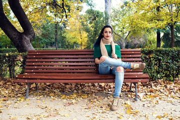Young woman sitting on a park bench