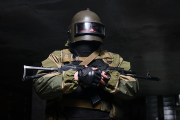 Russian soldier in helmet and flak jacket with weapon/Soldier with helmet on his head and flak jacket hold rifle in his hands.Selective focus
