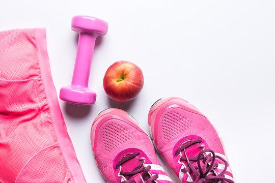 Women's sports bra,foot ware, Dumbbell and apple. Fitness wear a