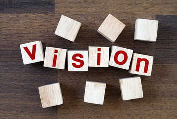 Vision word on wooden cubes background