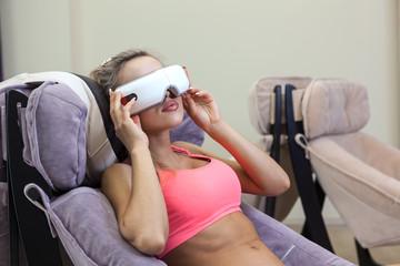 Woman getting eye massage at beauty salon