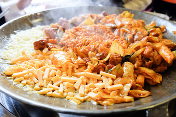 Fried Kim Chi with cheese, pork, egg, vegetables and noodles, Traditional Korean food.
