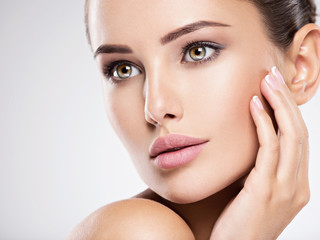 Young woman with beautiful face. Skin care treatment