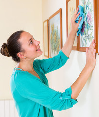 girl dusting the picture in gallery