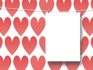 Close-up of one hanged paper sheet with pegs on red hearts illustration background