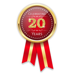 Red celebrating 20 years badge, rosette with gold border and ribbon