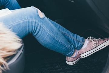 Passenger's legs in close-up