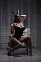 brunette woman with sexy lingerie and fluffy bunny ears