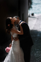 sweet romantic beautiful happy couple kissing at stone streets o