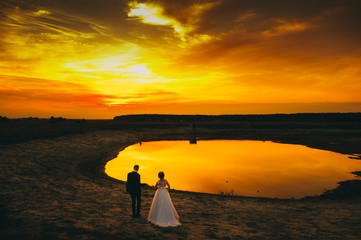 wedding couple on the background of sunset