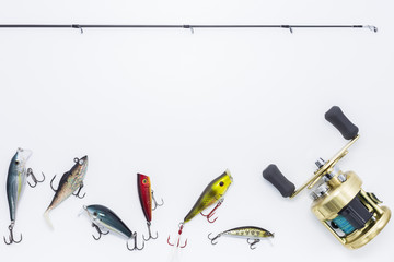 Fishing gear on  white background and space for text