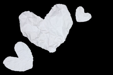 Wrinkled white paper hearts isolated on white