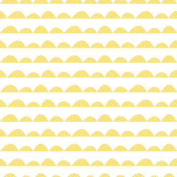 Scandinavian seamless yellow pattern in hand drawn style. Stylized hill rows. Wave simple pattern for fabric, textile and baby linen.