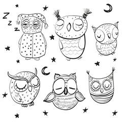 Set of sleeping owls