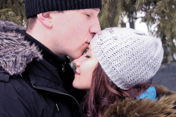 kissing couple in the winter forest