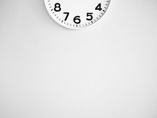 Half clock on the wall for background