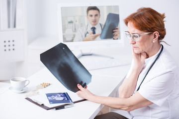 Modern doctor use technology in her work