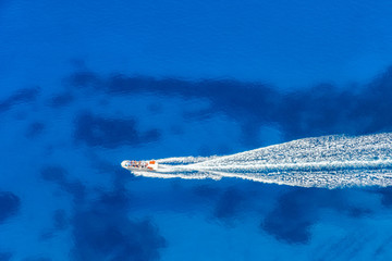 Aerial view of speed boat in azure sea