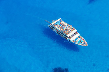 Aerial view of cruise boat in azure sea