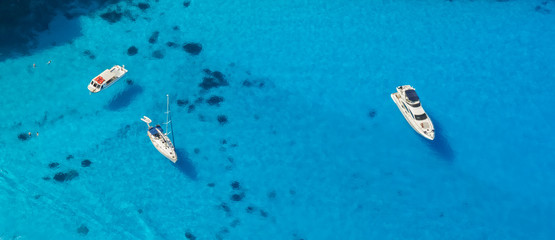 Aerial view of yachts in azure sea