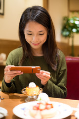 Woman take photo on her dessert