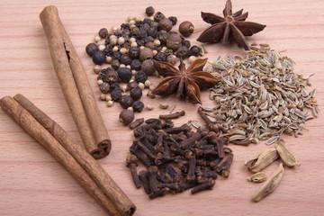 Exotic seasonings on a wooden board
