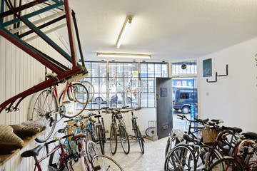 A bicycle shop, stocked with sports bikes, mountain and road bicycles,