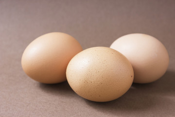 Brown eggs on a brown background