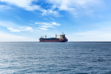Lonely ship in the ocean. Commercial container ship on the high seas