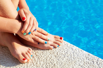 Vacation idea. Woman feet closeup. Beautiful pedicure. Girl rela