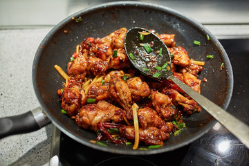 Chicken wings in a wok