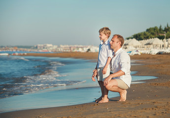 Father with son on the sea beach