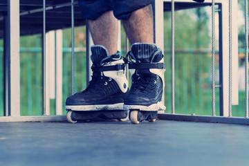 Aggressive inline skater in skatepark