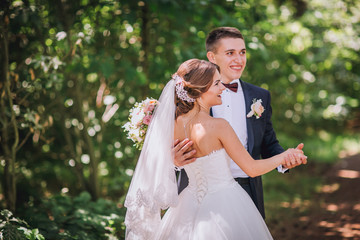 Married Couple in forest embracing and dancing