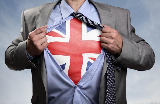 Superhero businessman revealing British flag