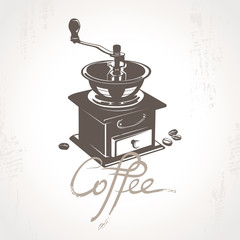 Coffee mill with some coffee beans