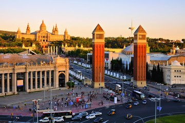 Aerial view over Placa d'Espanya towards the National Art Museum at sunset, Barcelona, Spain