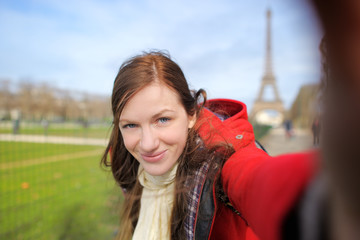 Woman taking selfie near the Eiffel tower