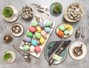 Easter still life. Table place setting with colored eggs