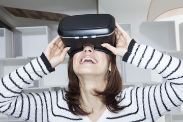 Woman is enjoying a virtual reality game