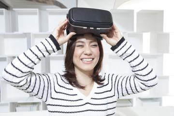 Woman is enjoying a virtual reality