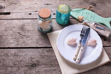 Nautical table setting on aged  wooden background.