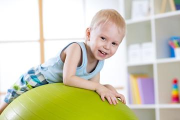 Kid having fun with  gymnastic ball