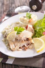fish with sauce and salad