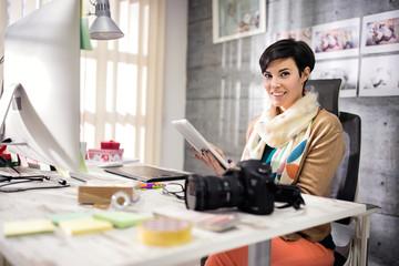 Business woman in designers studio at work